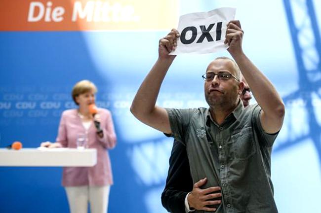 Illustration - Grexit : les USA mettent les pieds dans le plat d'Angela Merkel